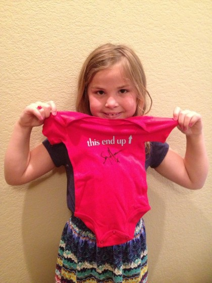 My daughter Kiya, now 7, holding her autographed Sammy onesie, signed at the Birthday Bash 2005, before her birth!