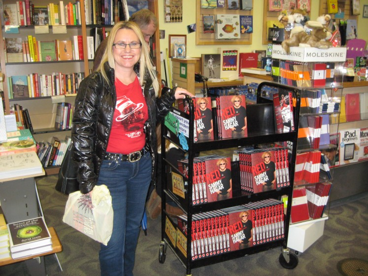 Posing with the Red Rocker books