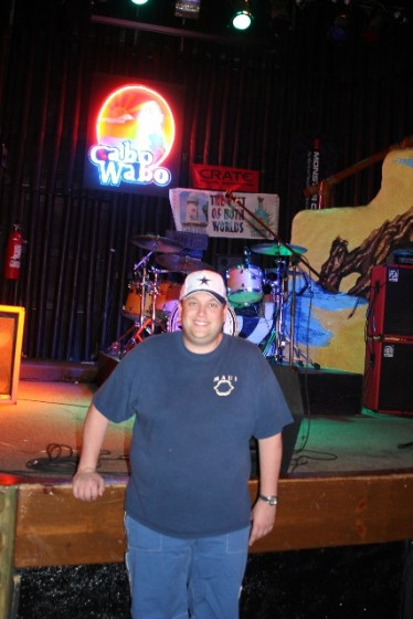 ME inside SAMMYs Bar, front center of stage where SAMMY plays