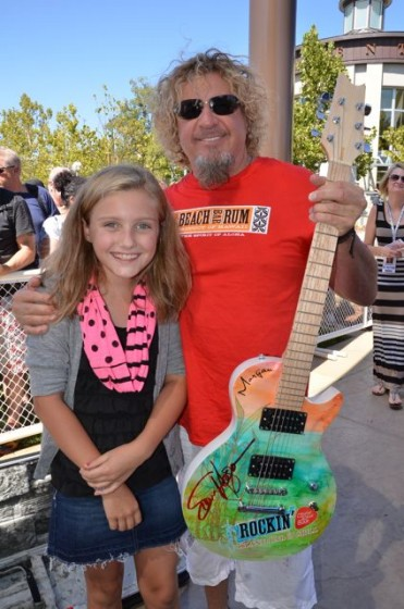 Young Red Head Gets Her Guitar Signed In Roseville, CA