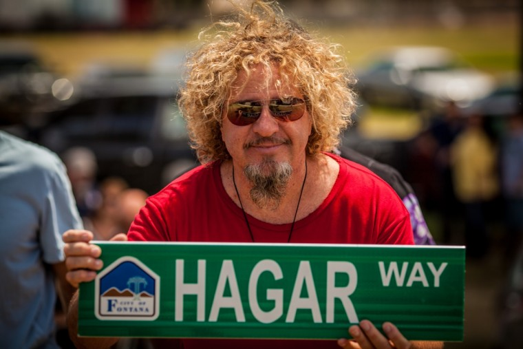 "Sammy shows off the sign for the new ""Hagar Way"" that will be built in Fontana"