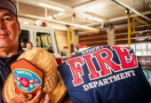 Fontana fire chief with gift for Sammy