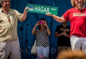 "Sammy and brother Bob show off sign for the new ""Hagar Way"" that will be built in Fontana"